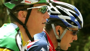 Tyler Hamilton (L) cycles with Lance Armstrong during the sixth stage of the Dauphine Libere cycling race from Gap to Grenoble in 2004