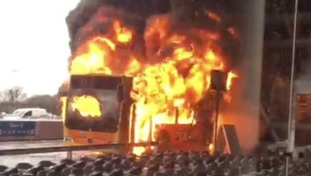 The bus on fire outside the terminal