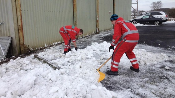 Paramedics clearing snow