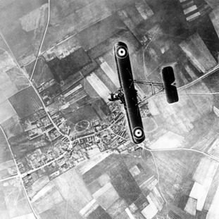 A fighter plane over the trenches of the Western Front during the First World War.