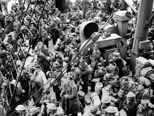 RAF airmen crowd the decks of a boat as they are evacuated from France in 1940.