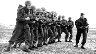 RAF airmen are taught to use sub-machine guns in 1942.
