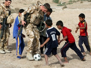 Members of the RAF play football with children in Basra, Iraq, in 2009.