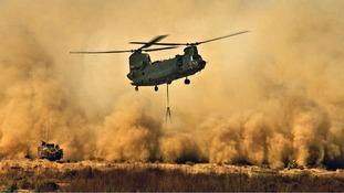 An RAF Chinook creates a dust storm in Delhi, India.