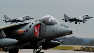 Harrier jump jets take off in 2010.