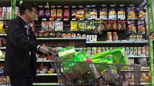 China slaps tariffs on US meat and fruit in trade war retaliation