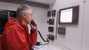 One of the crew tests out the radio before the grand voyage
