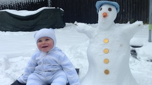 A baby and snowman