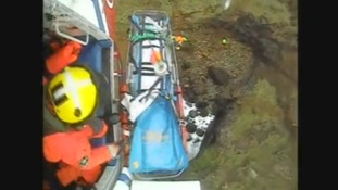 Rescuer looks out of a helicopter