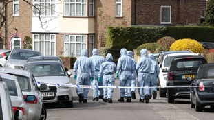 Forensic officers at the scene in South Park Crescent in Hither Green, London