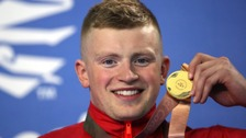 England's Adam Peaty with his gold medal in the Men's 100m Breaststroke Final at the 2018 Commonwealth Games.