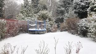 Empty trampoline in the snow in Maidstone