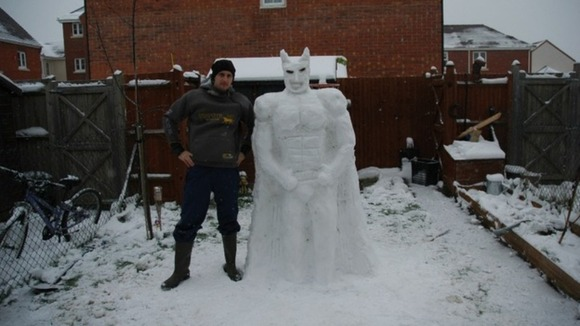 Superhero Batman is recreated in snow by Ashley and Mia Watts from Thatcham, Berkshire.