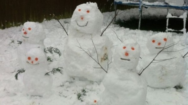 A snow family pictured in Cwmbran, Wales.