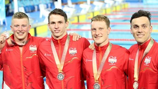 England's Adam Peaty, Benjamin Proud, Luke Greenbank and James Guy with their silver medals