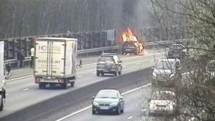 Car fire on M11