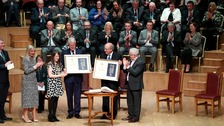 Bill Clinton and George Mitchell are awarded the freedom of Belfast.