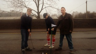 Residents fed up with potholes turn street into golf course