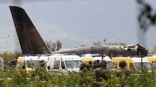 Many feared dead after a military plane carrying soldiers crashed in a farm field in northern Algeria.
