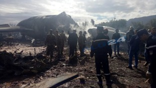 Firefighters and soldiers at the scene of a fatal military plane crash near Boufarik military base.