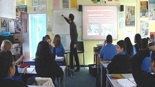 A teacher gives school children a lesson