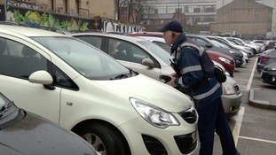 Traffic warden on the streets