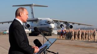 Putin speaking at a military airbase.