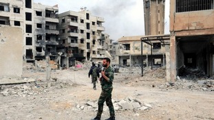 Syrian troops in the bombed out ruins on Douma