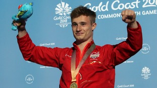 Team England's Jack Laugher with his gold medal following his victory in the men's 3m springboard final