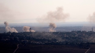 Smoke and explosions from the fighting between forces in Syria as seen from the Israeli-controlled Golan Heights.