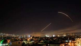 Missiles streak across the Damascus skyline as the U.S. launches an attack on Syria targeting different parts of the capital, early Saturday, April 14, 2018.