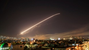 The Damascus sky lights up with service to air missile fire as the U.S. launches an attack on Syria targeting different parts of the Syrian capital Damascus, Syria, early Saturday, April 14, 2018.