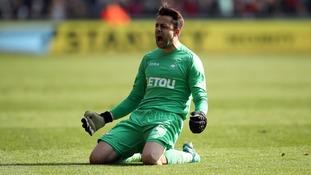 Swansea City goalkeeper Lukasz Fabianski celebrates a vital point against Everton.