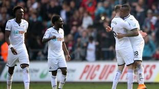 Swansea City's Jordan Ayew (right) celebrates with Alfie Mawson.