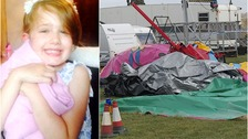 Father tried to save daughter as inflatable 'cartwheeled in the air'