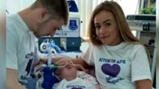 Alfie with his parents Tom Evans, 21, and Kate James, 20.