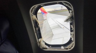 Photos of the plane on the tarmac showed a missing window