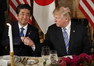 President Donald Trump shakes hands with Japanese PM Shinzo Abe before dinner at Trump's private Mar-a-Lago club