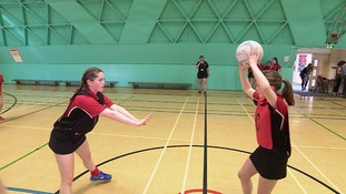 Girls playing netball at King Edward VI School