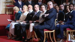 Members of the royal family and Commonwealth leaders listen intently to the Queen's address.