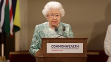 Queen Elizabeth II speaks at the formal opening of the Commonwealth Heads of Government Meeting in the ballroom at Buckingham Palace.