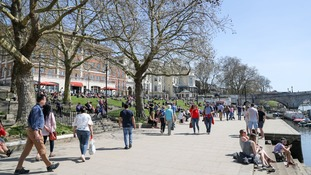 People enjoy the hot weather on Richmond riverside