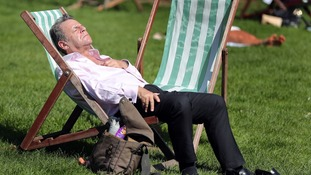 A man enjoys the weather in Green Park, London.