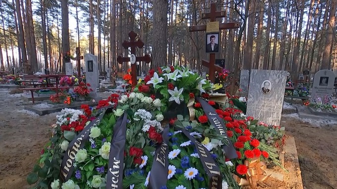 Borodin was buried beside his father - with colleagues placing newspapers and quills on his coffin.