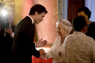 Canada's Prime Minister Justin Trudeau speaks to the Queen