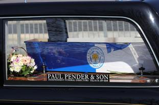 The hearse carrying Mary Ragoobeer makes its way to Leicester Cathedral.