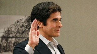 Magician David Copperfield is being sued by British tourist Gavin Cox.