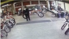 CCTV footage shows men stealing two motorbikes in Long Eaton shop.
