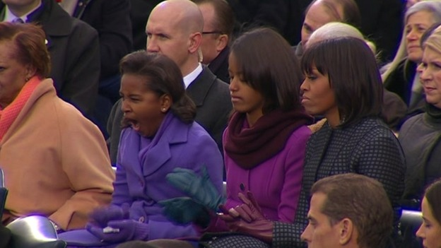 Sasha Obama seated next to her sister Malia and mother Michelle at the Inauguration