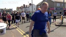 WATCH: Wigan Athletic fans walk for charity
